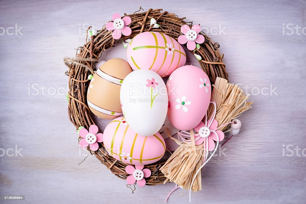 Easter eggs painted in pastel colors in the nest stock photo