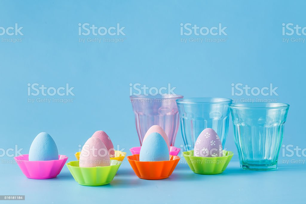 Easter eggs stay on blue background stock photo