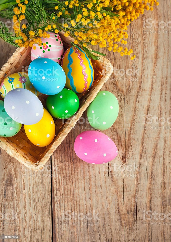 Easter eggs with branch of mimosa flowers stock photo