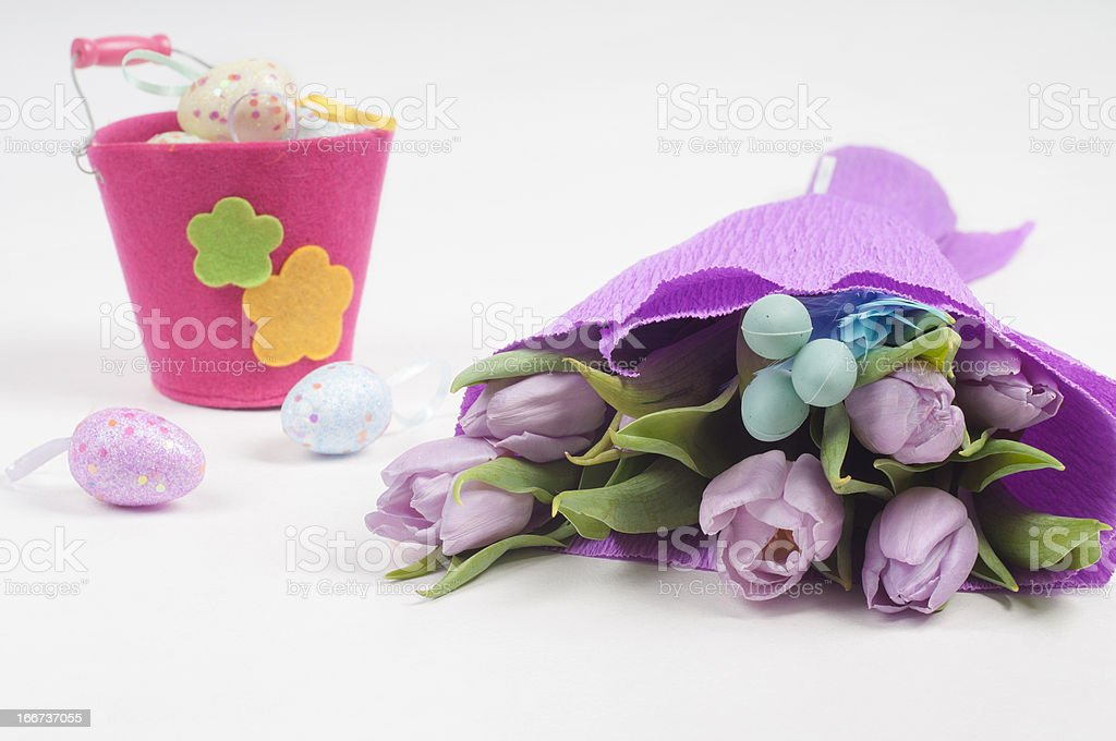 Easter eggs with bucket and tulips royalty-free stock photo