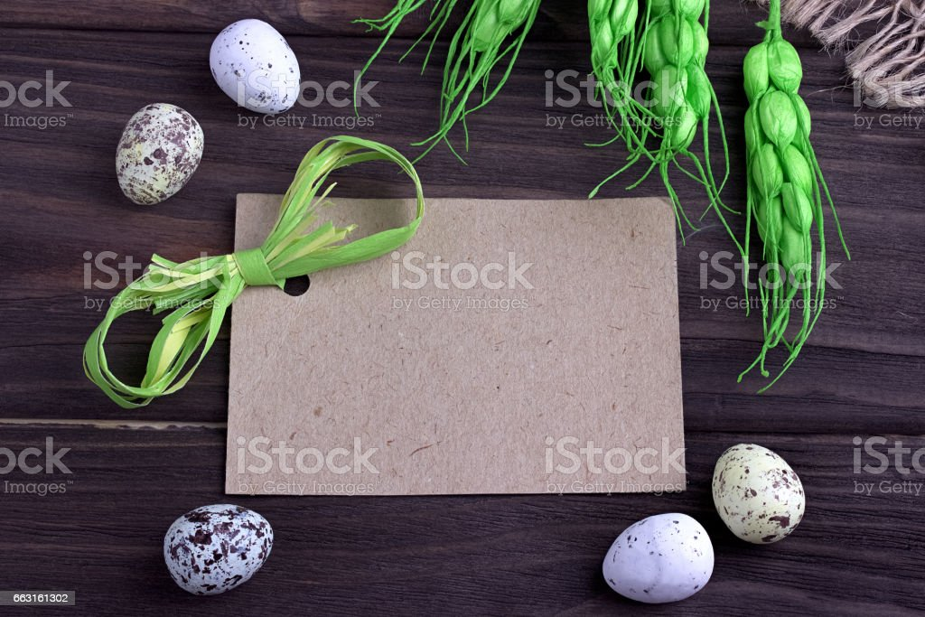 Easter eggs with burlap cloth yellow branches green ribbon and space for text. stock photo