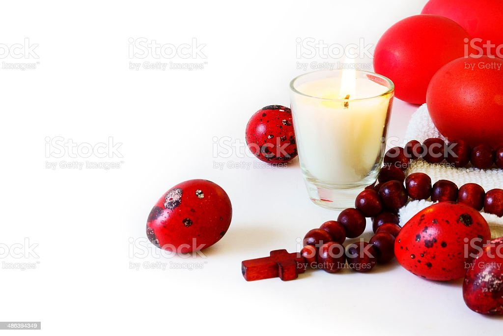 Easter eggs with candle and rosary royalty-free stock photo