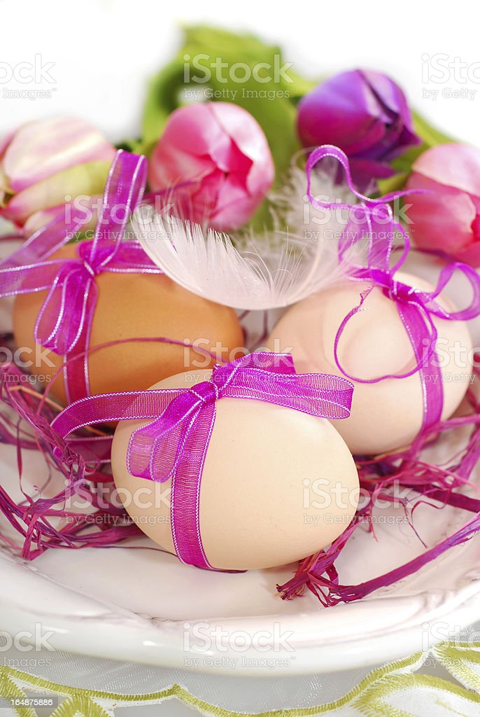 easter eggs with pink ribbon on the plate royalty-free stock photo