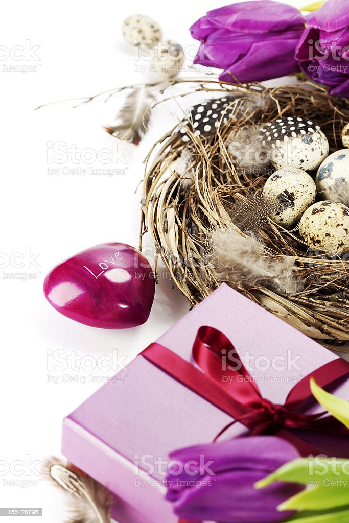 easter eggs with purple tulip flowers and gifts royalty-free stock photo
