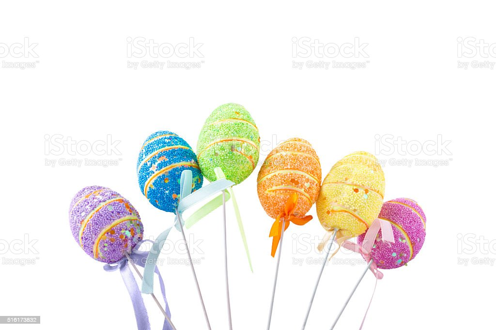 Easter eggs with sticks on white background stock photo