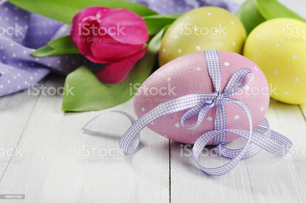 Easter eggs with violet ribbon royalty-free stock photo