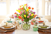 Easter Elegant Place Setting Dining Table with Vase of Tulips