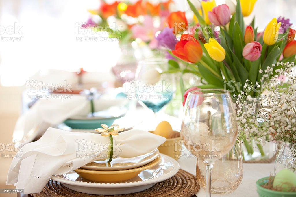 Easter Elegant Place Setting Dining Table with Vase of Tulips stock photo