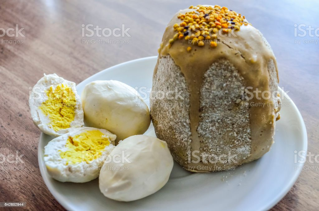 Easter food with Kulich cake and eggs stock photo