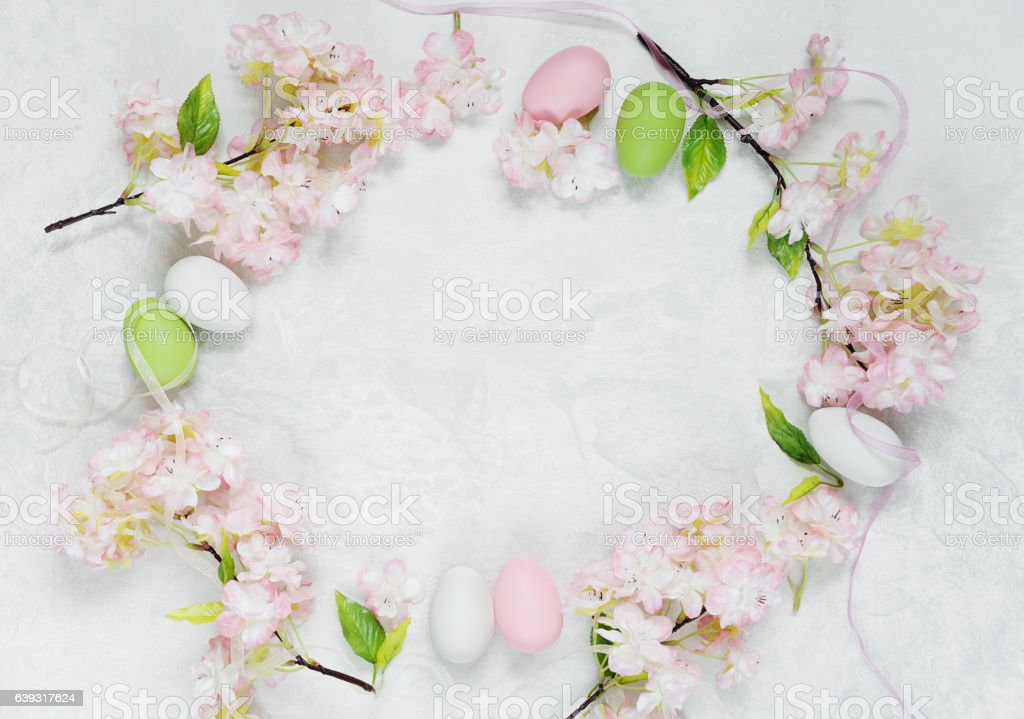 Easter frame with flowers and Easter eggs stock photo