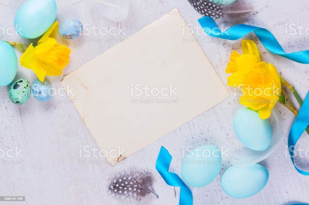 Easter frame with painted eggs and flowers stock photo