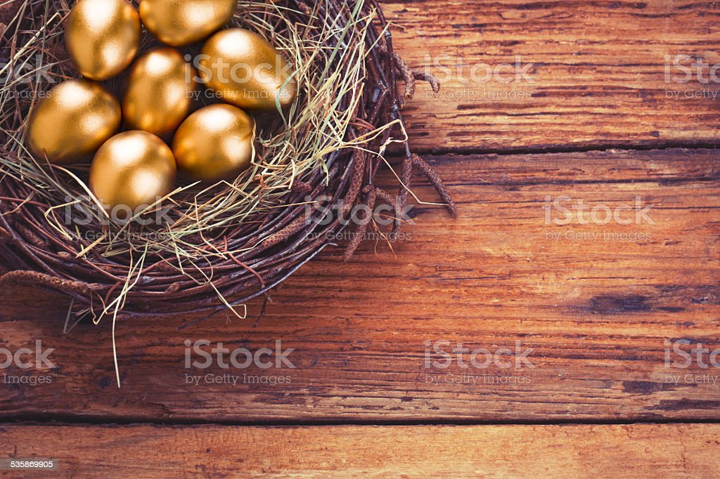 Easter gold eggs stock photo