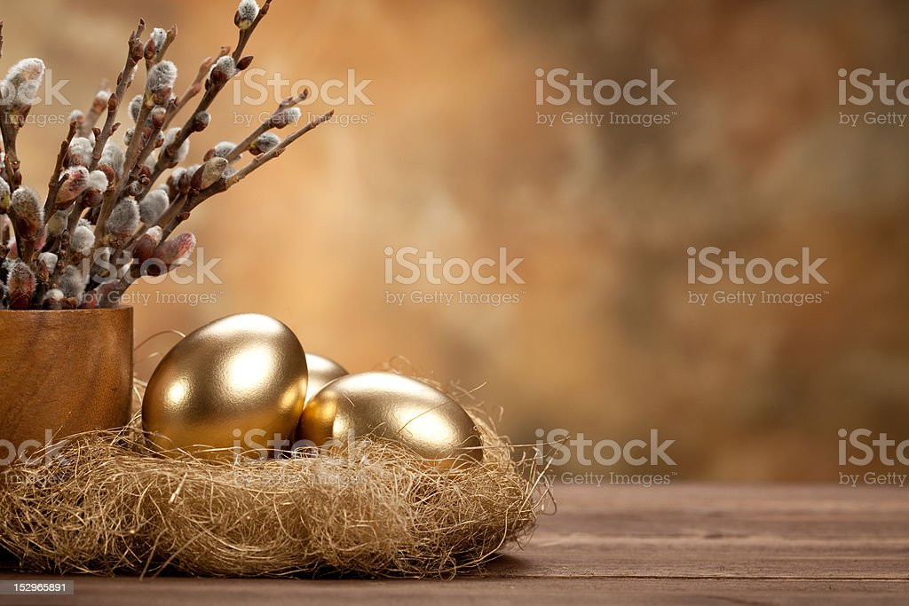 Easter - Golden eggs in the nest stock photo