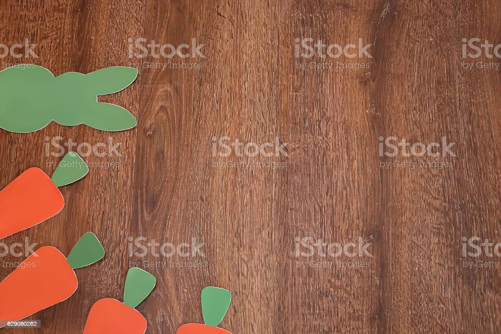 Easter green rabbit  and  carrots on  background stock photo