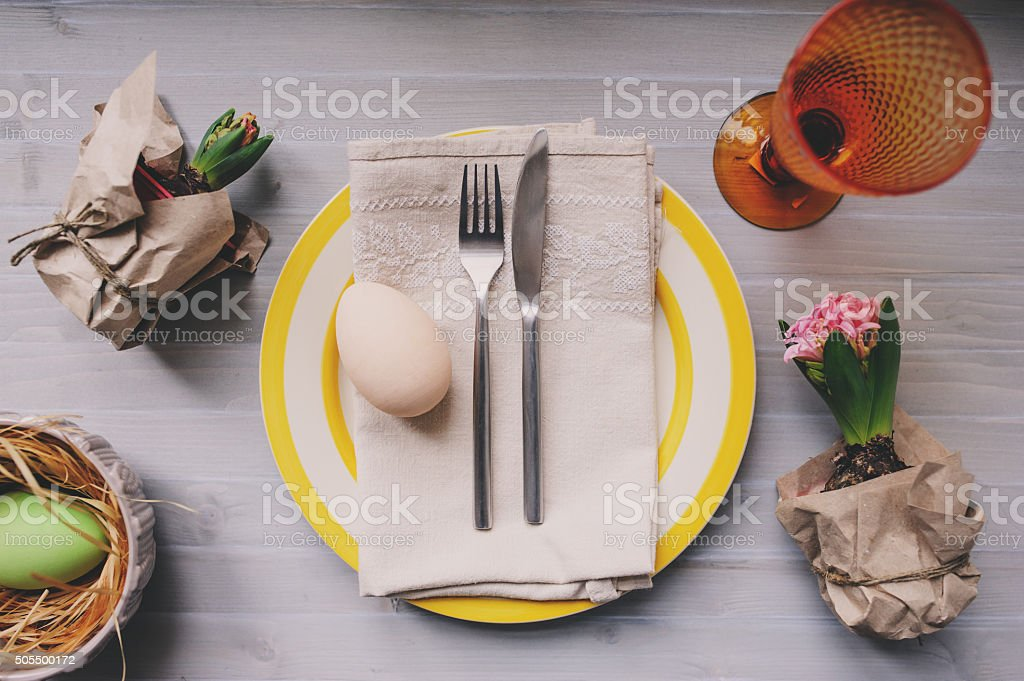 Easter holiday dinner at home. Table setting top view. stock photo