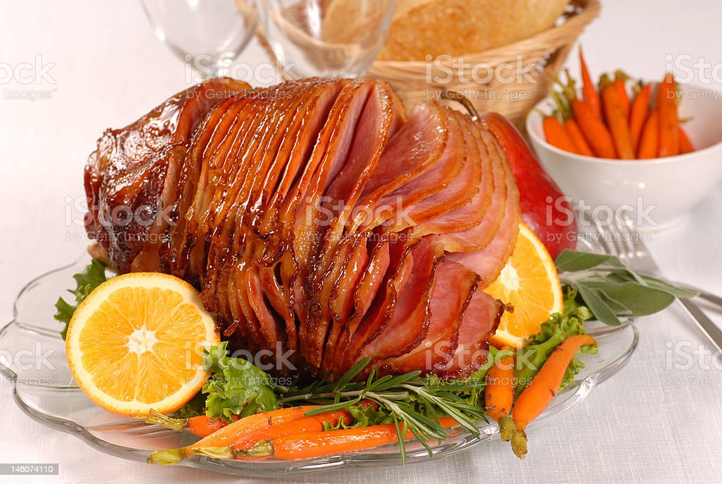 Easter honey glazed ham with carrots stock photo