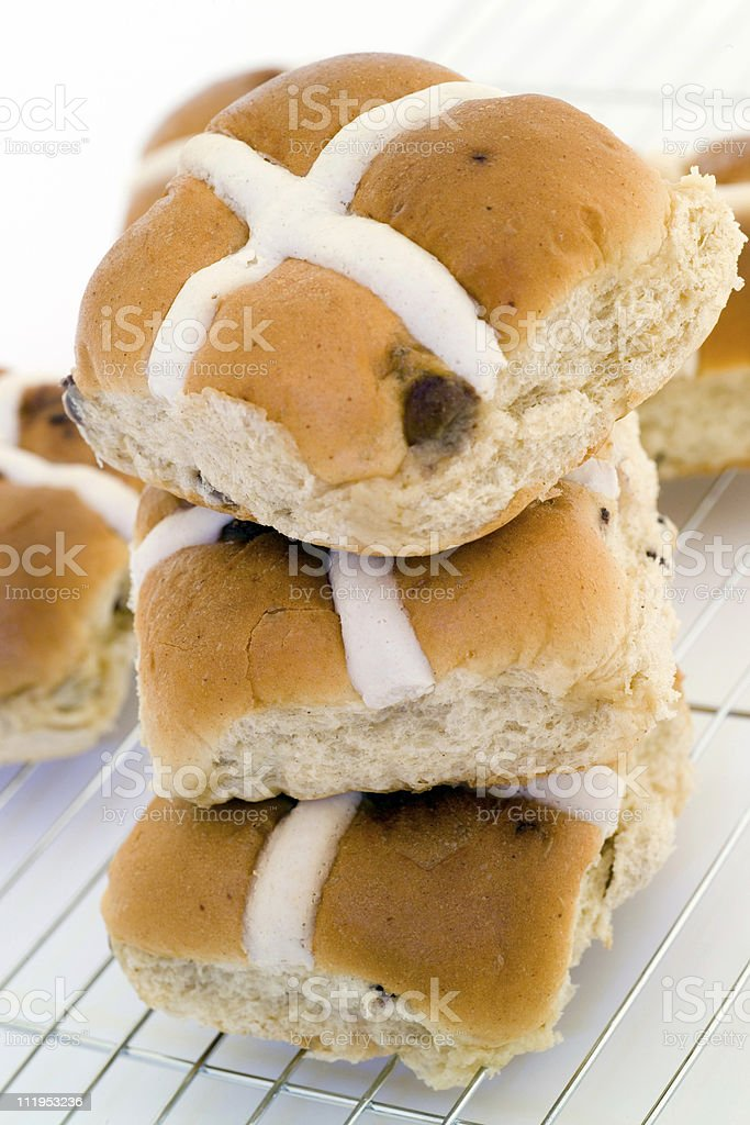 Easter Hot Cross Buns on a cooling rack royalty-free stock photo