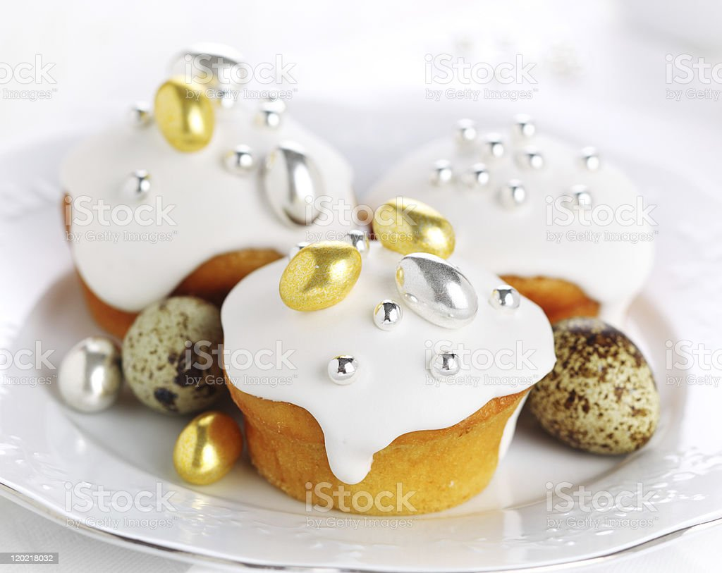 Easter iced cake with gilded dragees royalty-free stock photo