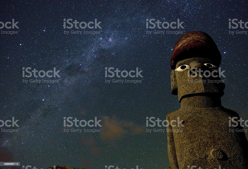 Easter Island moai statue under starry sky, Chile. stock photo