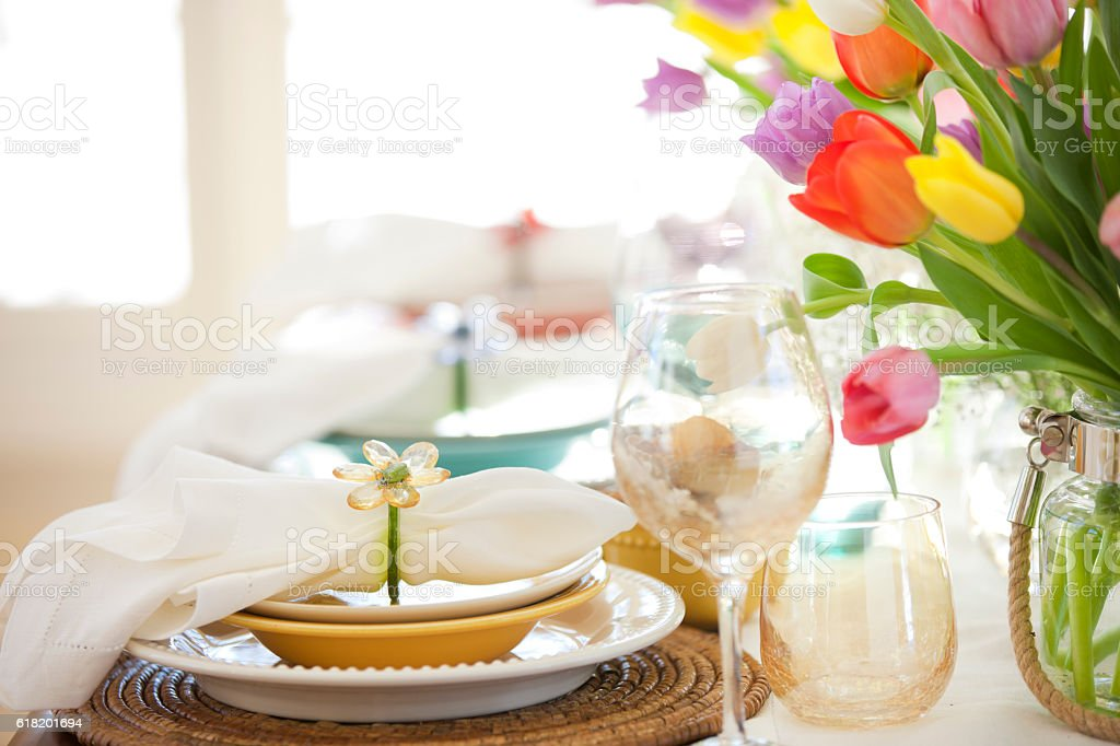 Easter Morther's Day Elegant Place Setting Dining Table and Tulips stock photo