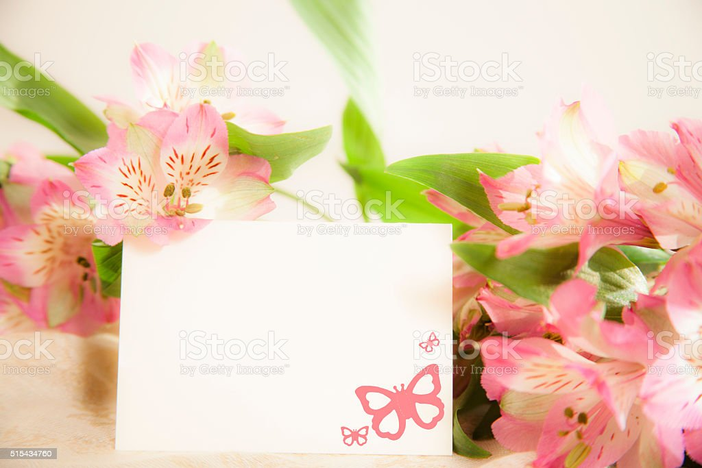 Easter, Mother's Day. Flower bouquet with blank notecard. stock photo