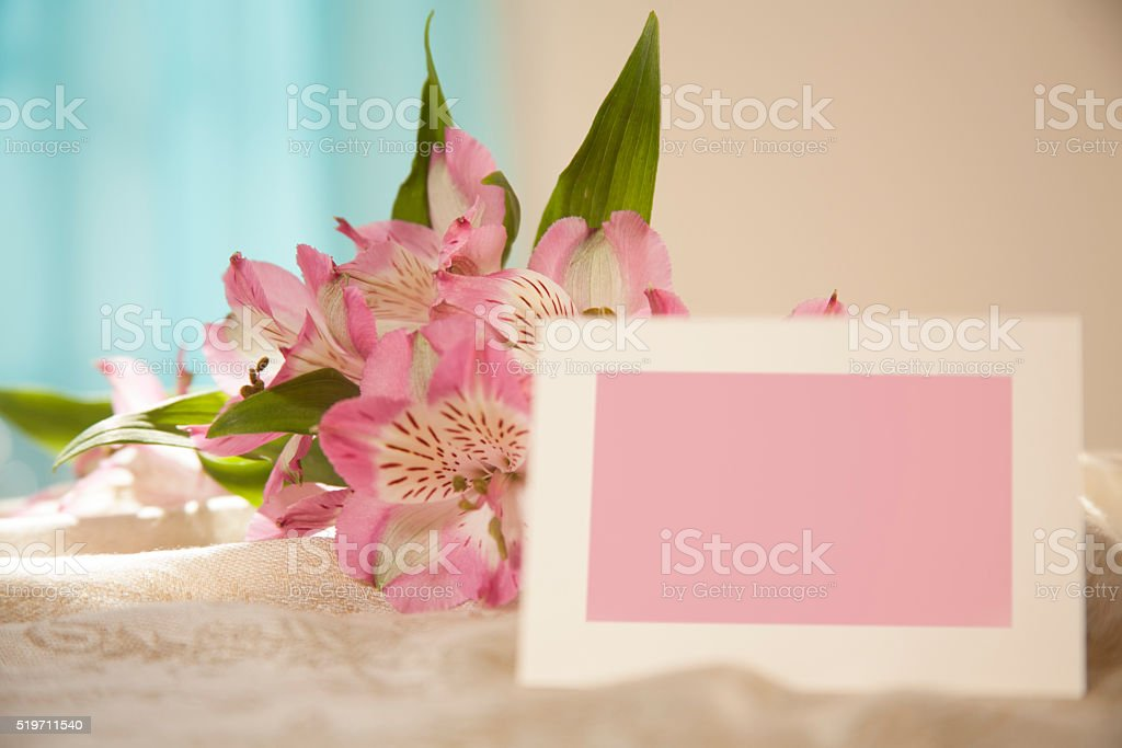 Easter, Mother's Day. Flower bouquet with pink blank notecard. stock photo