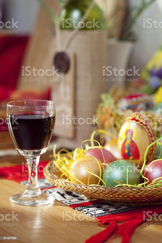 Easter painted eggs and wine glass on table royalty-free stock photo