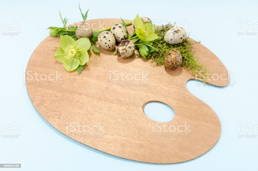 Easter palette decoration with seven boiled quail eggs plus hellebore stock photo