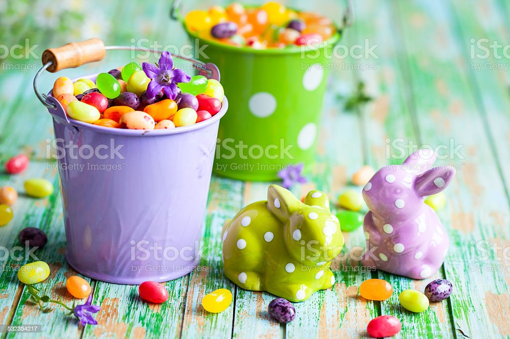 Easter rabbits and candy stock photo