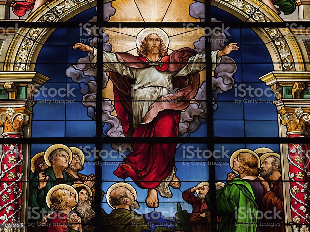Stained glass window depicting Jesus Christ\'s resurrection at Easter.