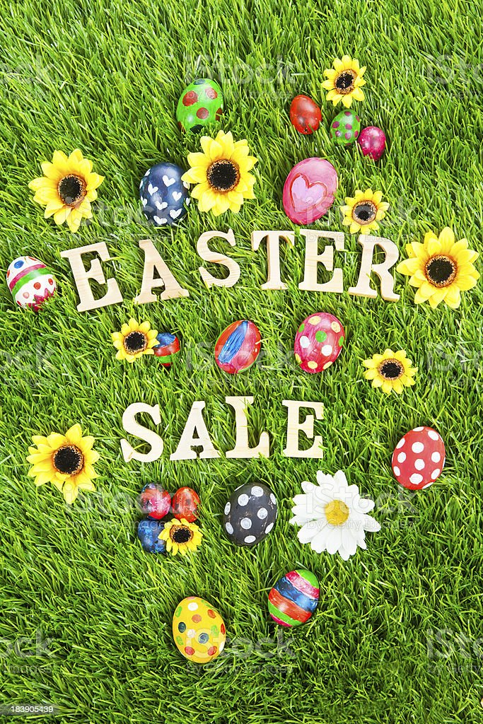 Easter sale eggs on grass vertical royalty-free stock photo