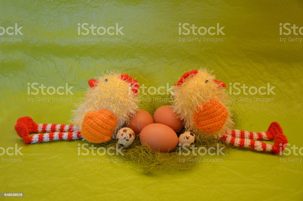 Easter scene with chick  and eggs against yellow background stock photo