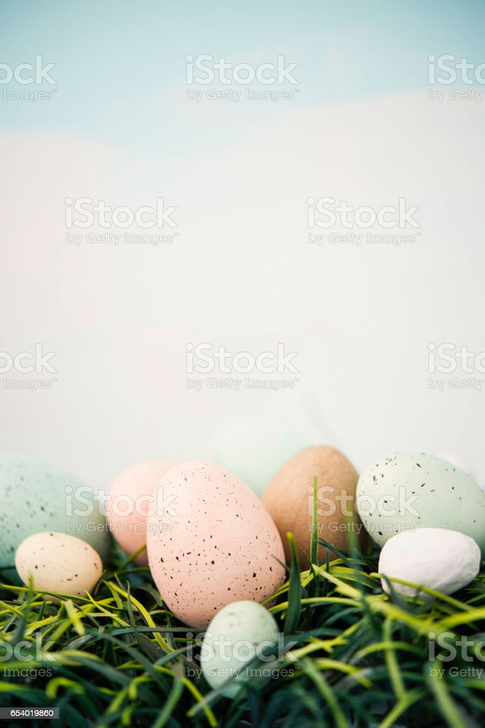 Easter still life in pastel colors. Eggs in grass stock photo