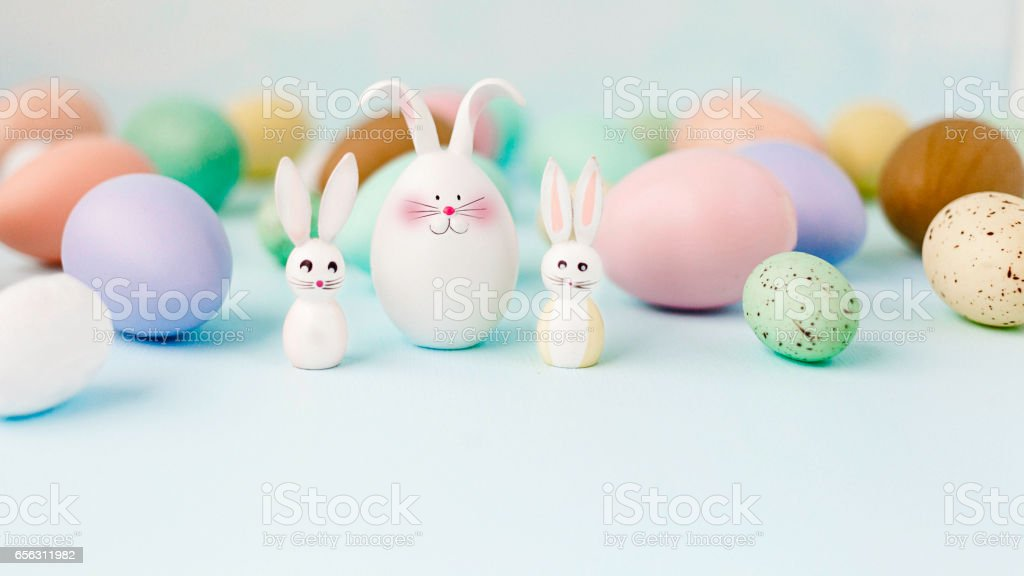 Easter still life in pastel colors with eggs and rabbits stock photo