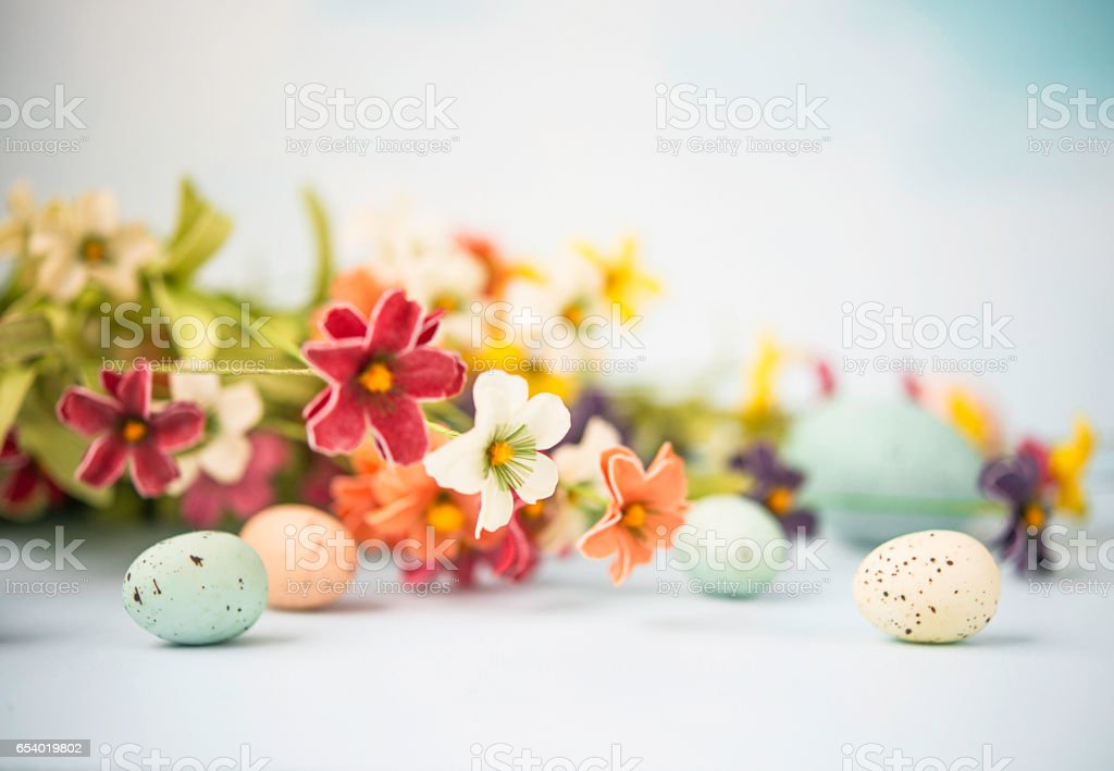 Easter still life in pastel colors with flowers and eggs stock photo