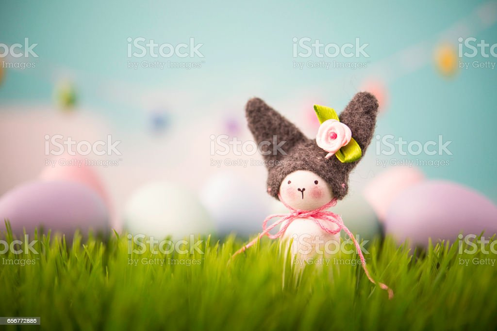 Easter still life with handmade bunny in grass stock photo