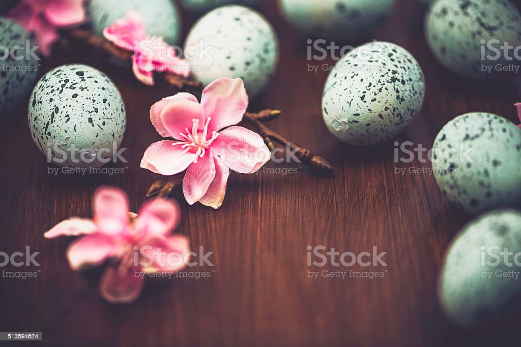 Easter still life with speckled eggs and blossoms stock photo