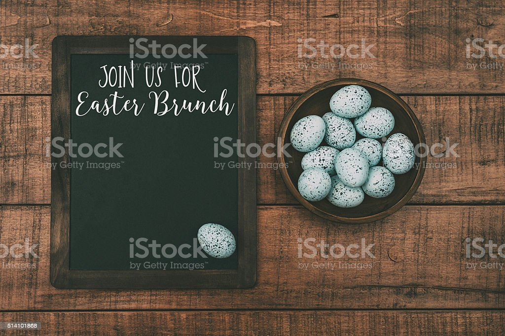Easter still life with speckled eggs and Easter Brunch message stock photo