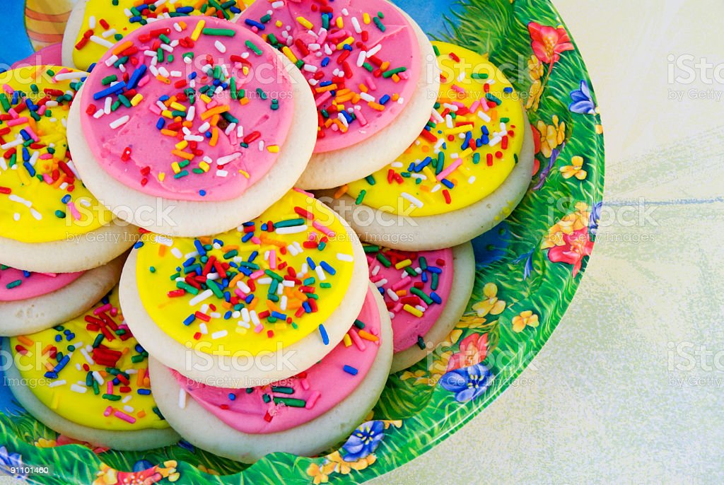 Easter sugar cookies with pink and yellow buttercream icing royalty-free stock photo