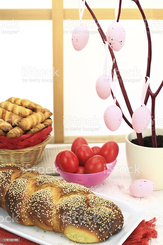 Easter sweet bread with red eggs and shortbread cookies royalty-free stock photo