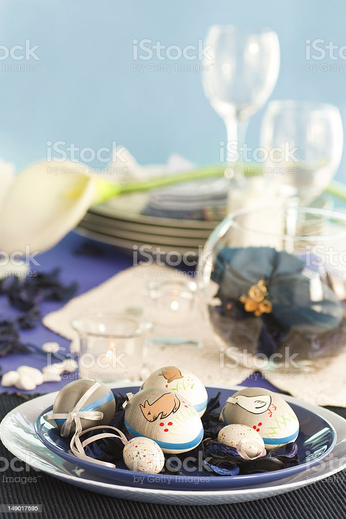 Easter table setting in blue and white tones royalty-free stock photo
