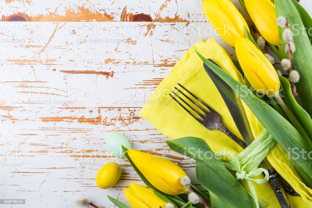 Easter table setting with fluffy willow and tulips stock photo