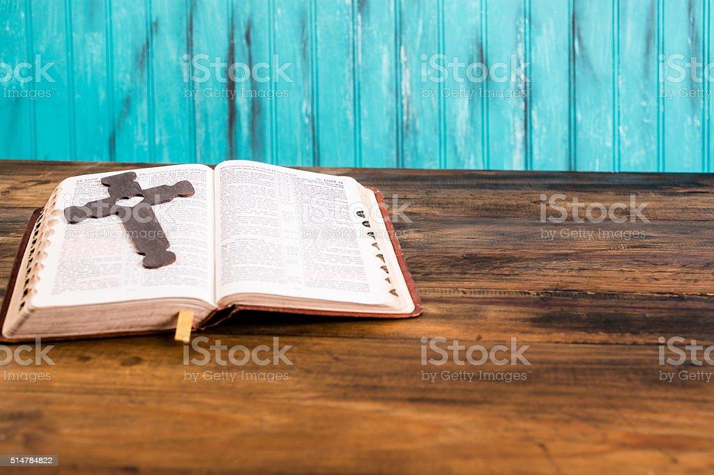 Easter.  Wooden cross on open Christian Bible. stock photo