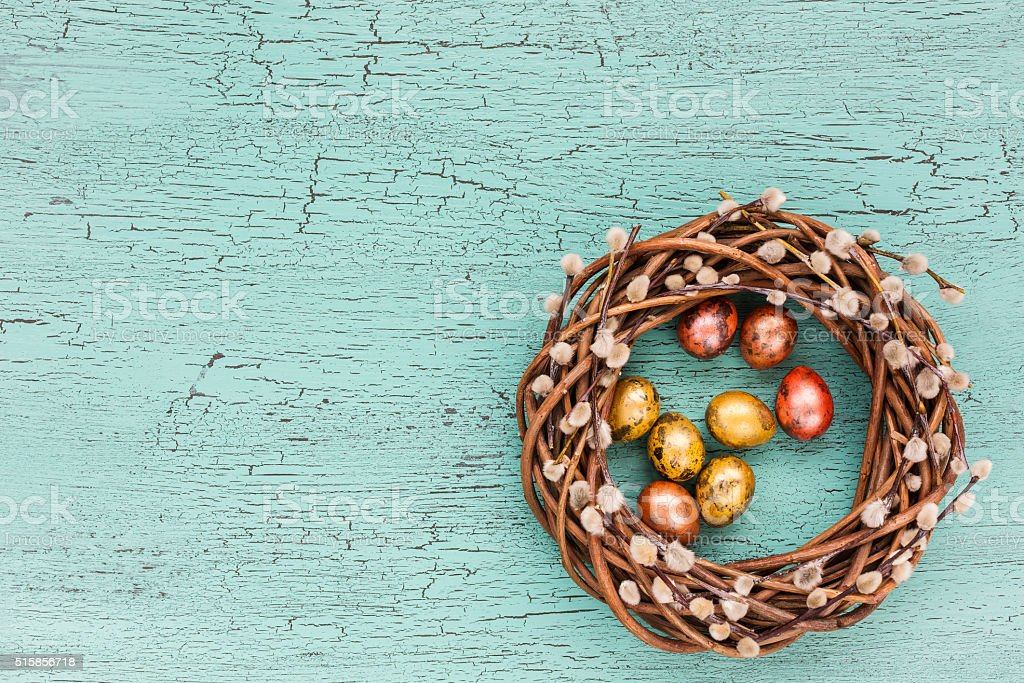 Easter wreath on blue background. Top view, copy space stock photo