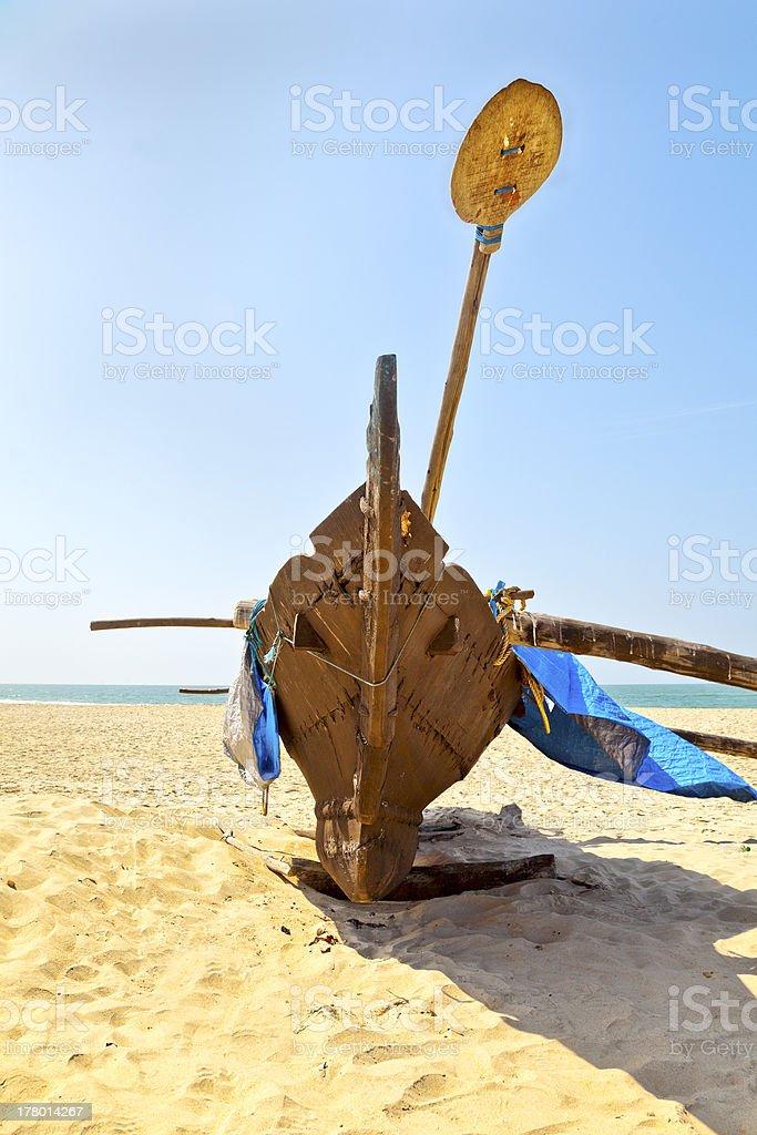 Eastern catarmaran signle hull outrigger paddle royalty-free stock photo