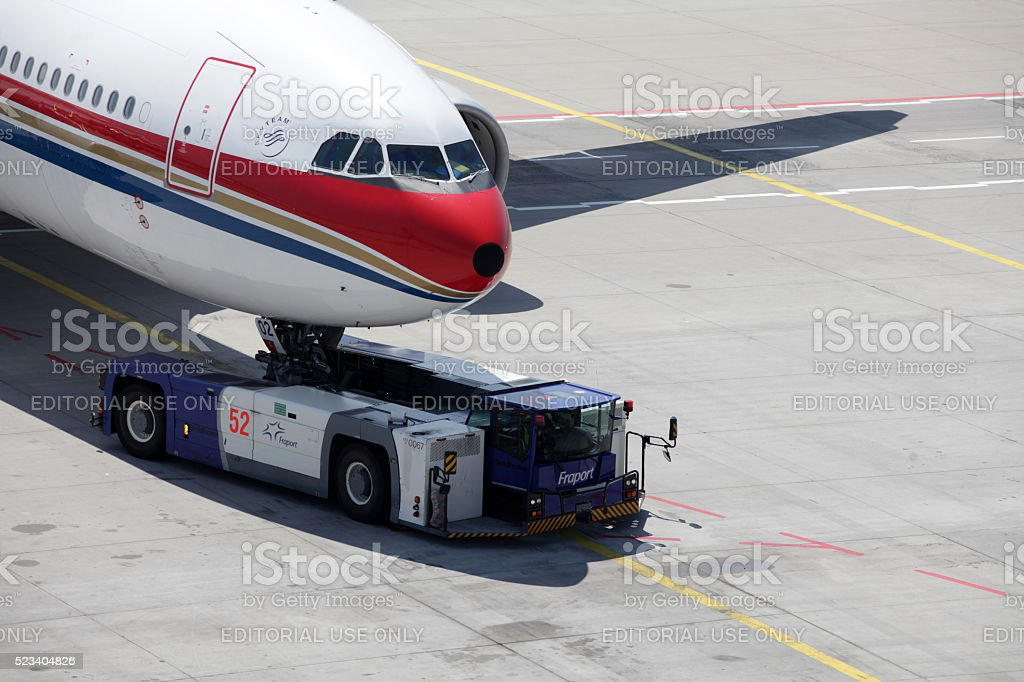 Eastern China Airways plane being towed to gate stock photo
