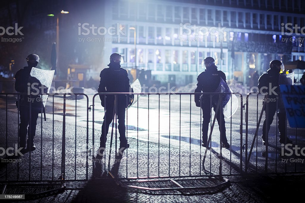 Eastern Europe Riot police behind the fence stock photo