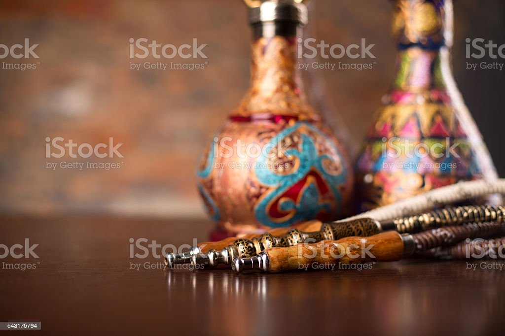 Eastern hookahs on wood table stock photo