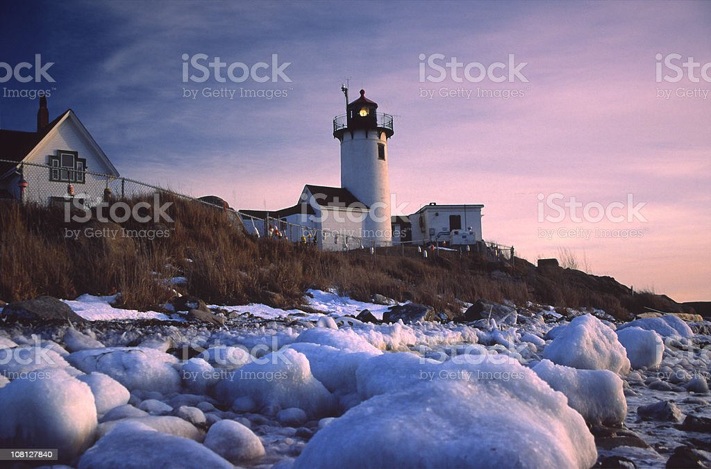 Eastern Point Lighthouse and Shore at Dusk royalty-free stock photo