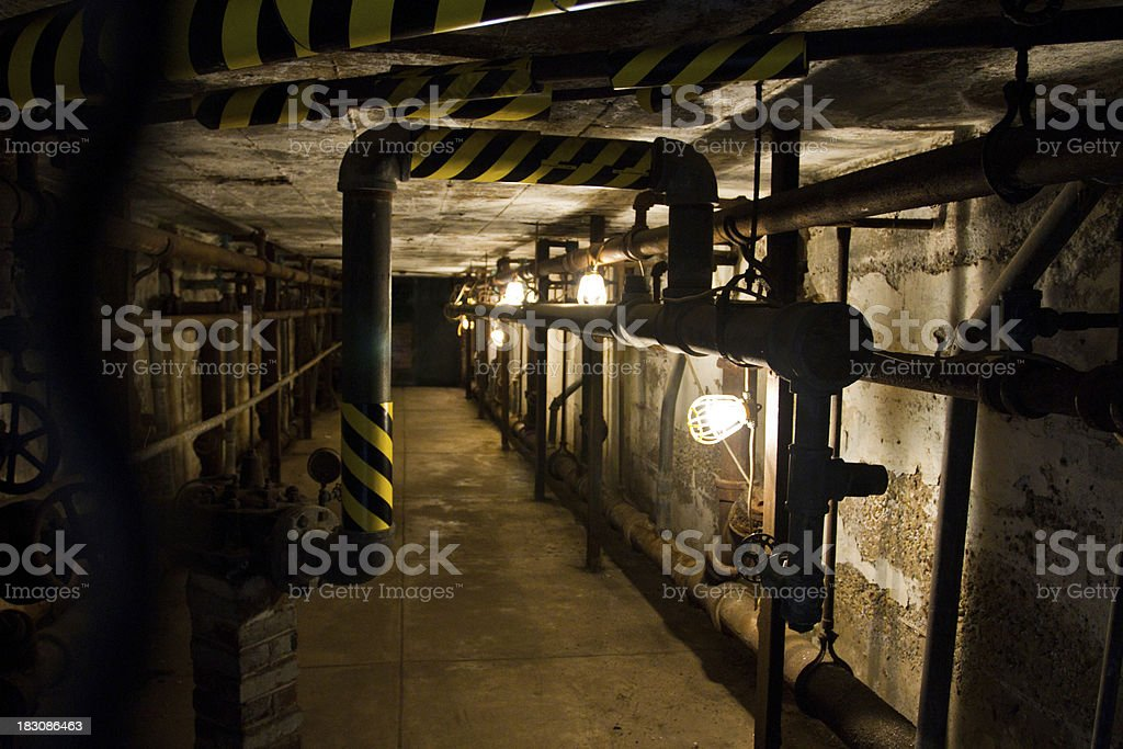 Eastern State Penitentiary Prison, water pipes under the cells stock photo